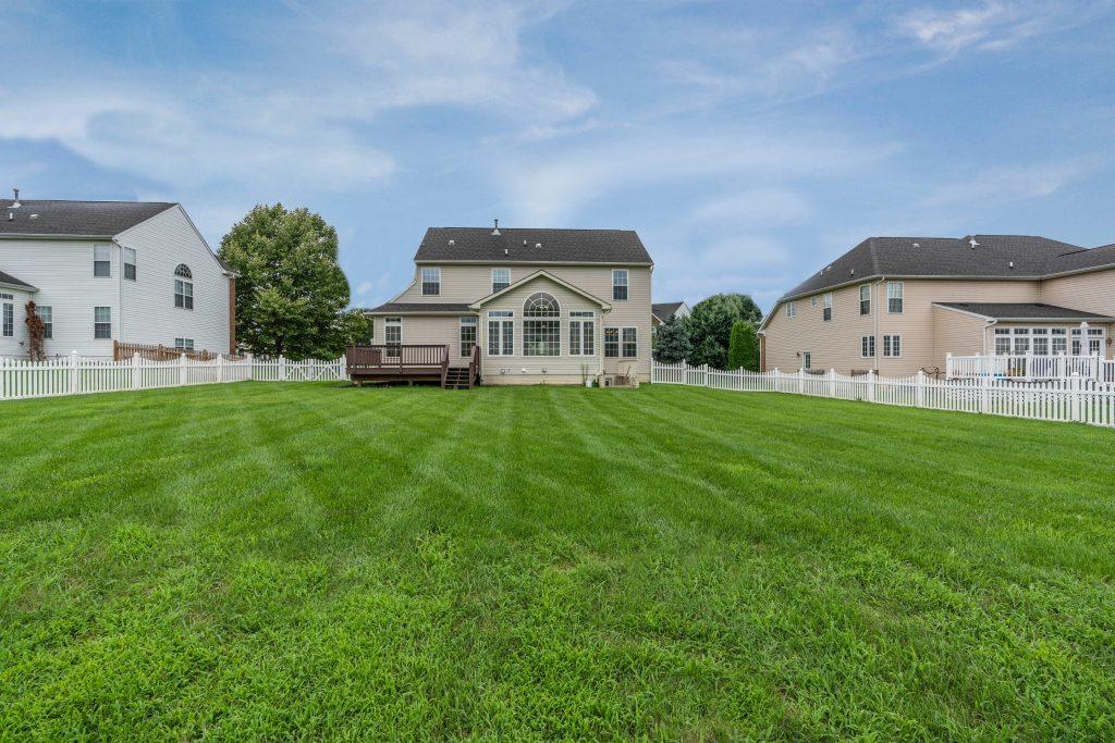Suburban home with big green backyard.