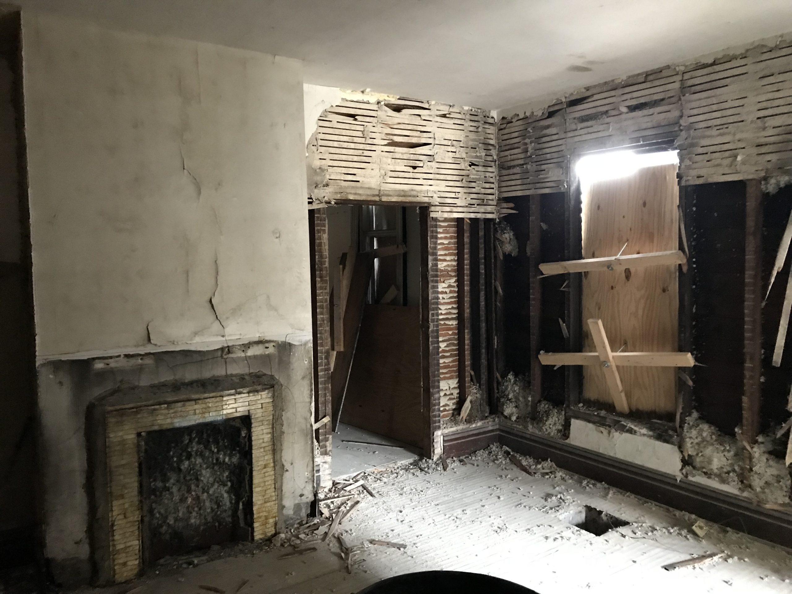 Inside of a gutted home during an Upward Home Solutions renovation project.