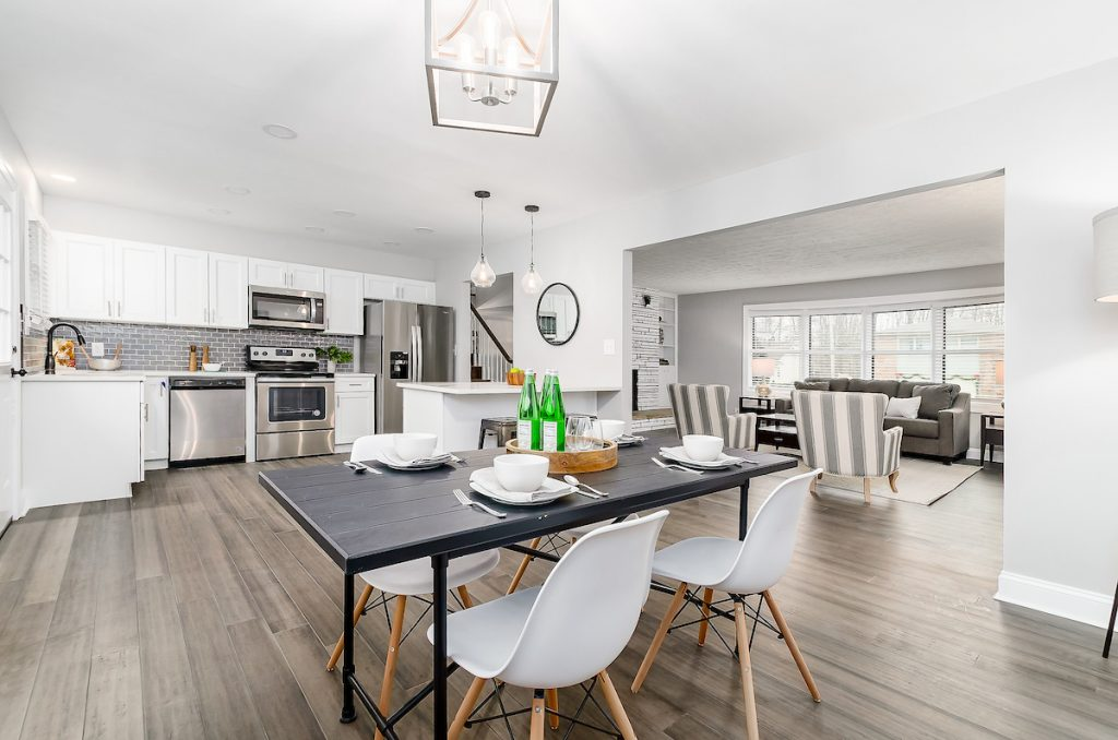 A kitchen with stainless steel appliances and a kitchen table.