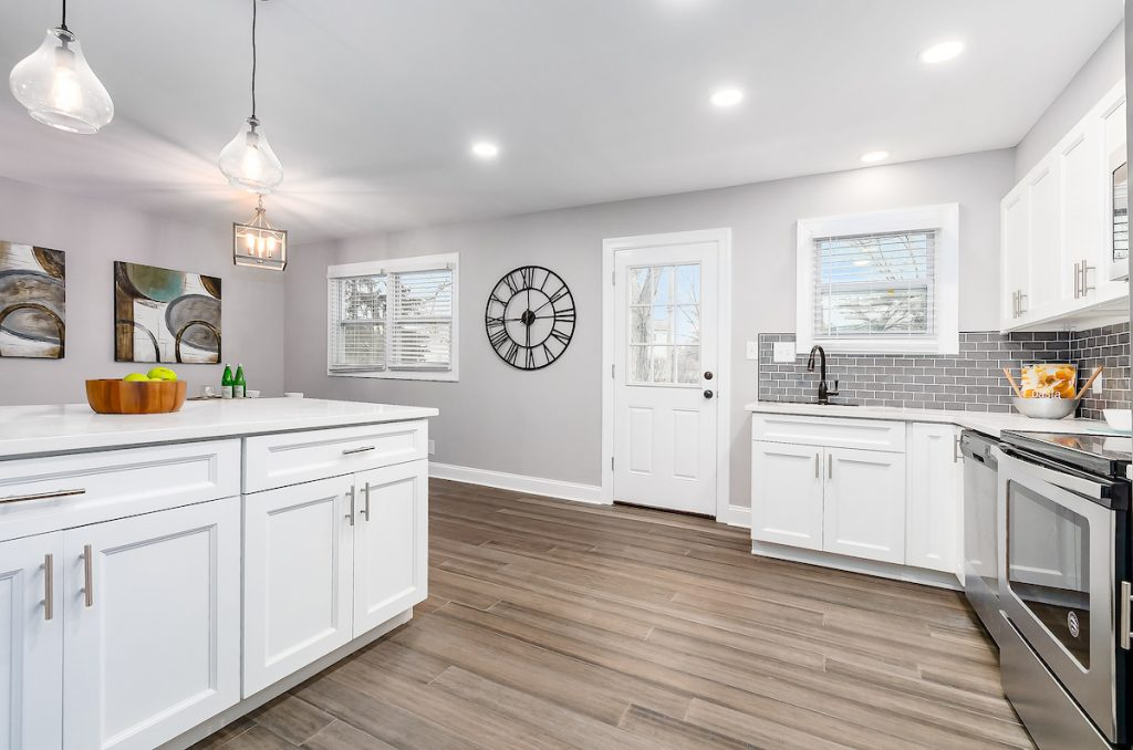 A kitchen with all white cabinets.