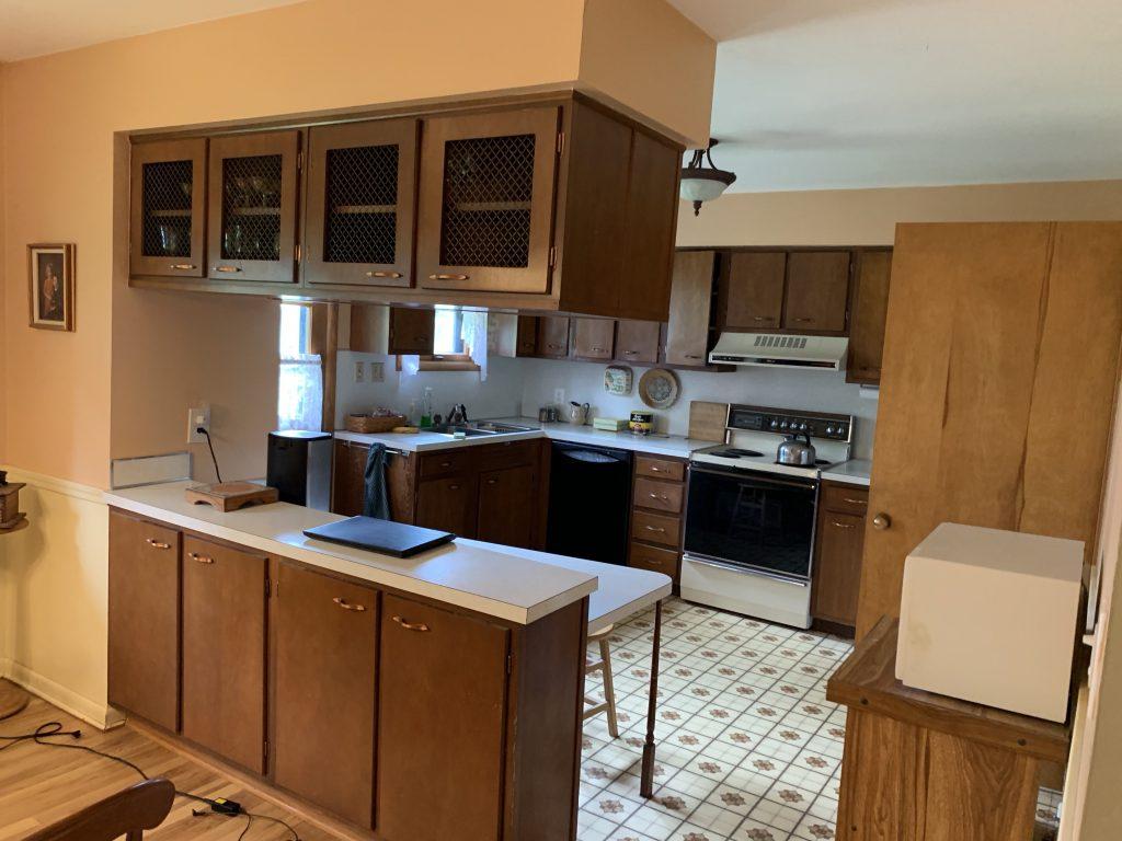 A kitchen with linoleum floors.