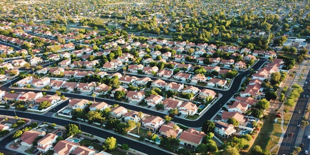 A birds-eye view of a sprawling suburban neighborhood.