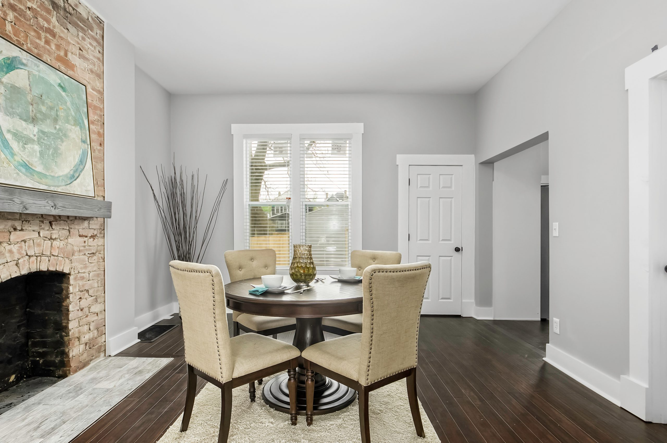Four chairs positioned around a living room table in a home with white paint on the walls.