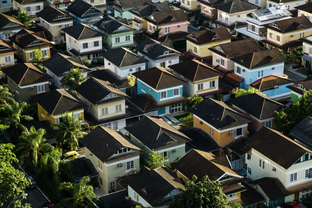 A birds-eye-view of about thirty different brightly colored suburban homes in a Brazilian neighborhood with no real estate market crash in sight.