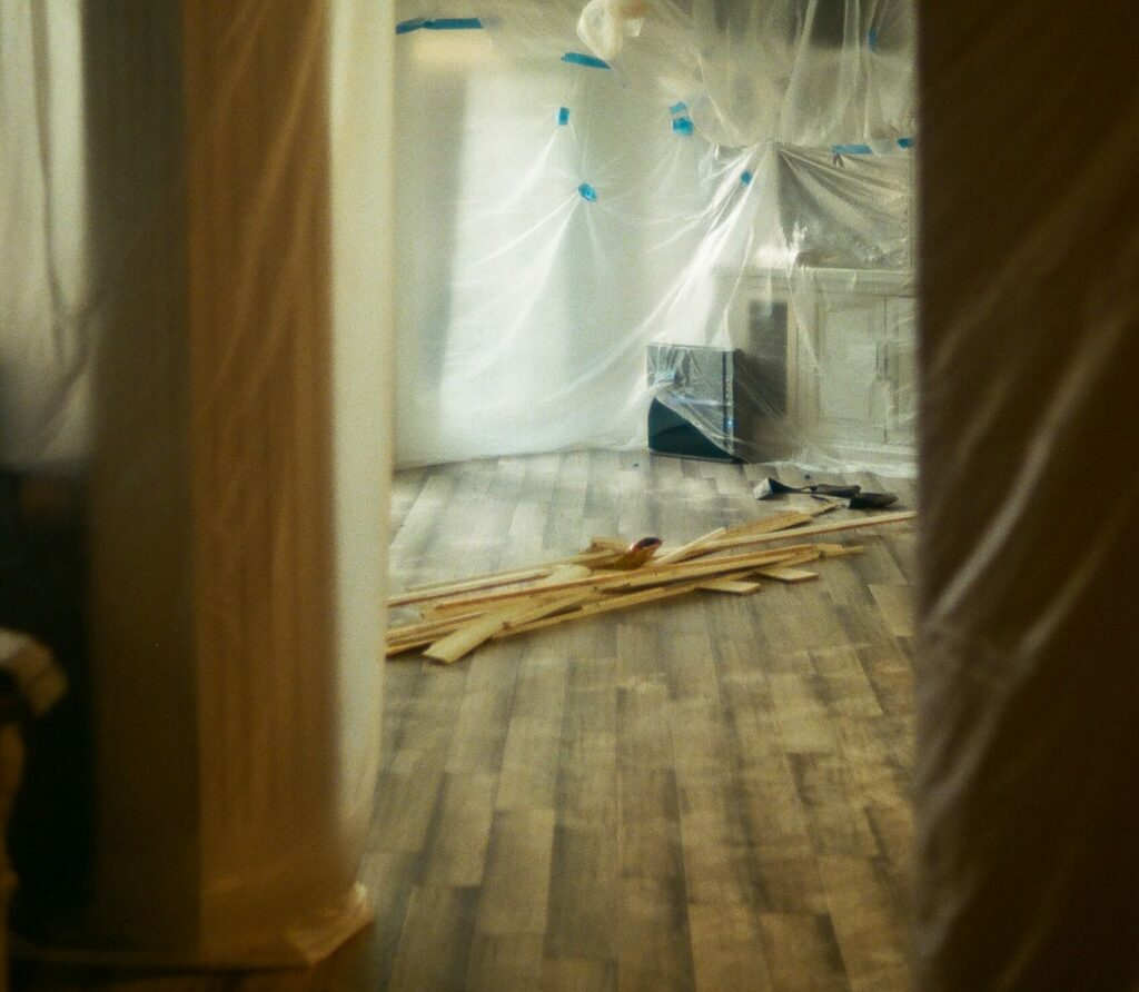 Plastic sheeting on the walls inside a home during a renovation project.